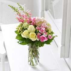 A beautiful pastel yellow and pink display as a wedding table centrepiece.