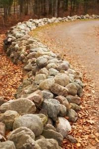 How to Landscape With Rock Borders... would work great for going up the driveway