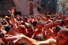 Look like fun? This is the famous Spanish festival, La Tomatina.  Known as the world's biggest food fight, the festival takes place in the Valencian town of Buñol where revellers pelt each other with tomates. Why not, eh?  Here are the rules:  1) The tomatoes have to be squashed before throwing to avoid injuries.  2) No other projectiles except tomatoes are allowed.  3) Participants have to give way to the truck and lorries.  4) The festival doesn't allow ripping off T-shirts.