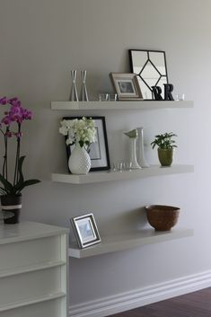 Floating shelves to fill an empty space - @Kristen Kluk need to do this beside our TV!!