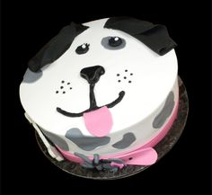 Puppy Dog Birthday Cake,  White buttercream iced, round decorated with a sweet puppy dog face, complete with collar and dog tag. Everything on this cake is EDIBLE.   (Serves 8-80 party slices)