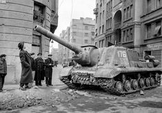 Passersby look up at a disabled Soviet tank after the first Soviet departure. People wandered the streets, finding it hard to believe they had driven the enemy away Isu 152, Border Guard, Ww2 Tanks, World Of Tanks, Military Photos, Budapest Hungary, Historical Pictures, Life Magazine, Cold War