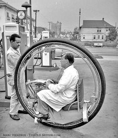"""Walter Nilsson's Uno-Wheel, The well-known """"Life"""" magazine photo referred to earlier in the text of Nilsson smoking at the gas pumps with the Uno-Wheel. Note the construction of the seat that appears to be re-purposed from military surplus. Vintage Bikes, Vintage Cars, Monocycle, Lifted Cars, Pedal Cars, Retro Futurism, Gas Station, Transportation, Classic Cars"""