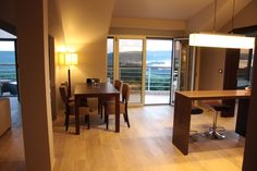 Penthouse apartment at Tivat Heights, Montenegro. Dining area with views over the Tivat Bay.