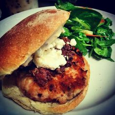 Burger night! Homemade 8oz Chicken & Bacon Burger with Peat-smoked Chèvre Noir Goat Cheese, Sun-dried Tomato Mayo, Kalamata Olive Tapenade and a Mixed Green Salad