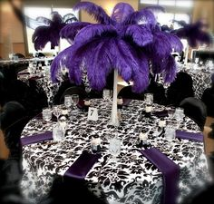 Dramatic purple ostrich feather centrepieces. www.reflectionsweddings.ca