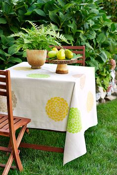 Canvas drop cloth turned stylish tablecloth: Dress up a table on the cheap by using a new cotton drop cloth cut to fit. Finish the edges with no-sew hemming tape, and stencil on a design.