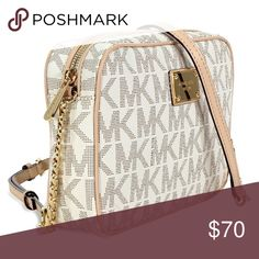 Michael kors jet set crossbody White and gold with gold trim. Signature logo. Leather. Very good condition. Michael Kors Bags Crossbody Bags