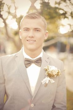 Grooms clothes, along with bride gorgeous makeup and pretty gloves