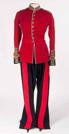 A BRITISH VICTORIAN GRENADIER GUARDS LIEUTENANT'S TUNIC AND TROUSERS, circa 1900. Red wool tunic with dark blue wool collar and cuffs and white piping throughout. Collar and cuffs richly embroidered in gold bullion with flaming bomb regimental badges. Dark blue shoulder straps with rank insignia. Complete with dark blue trousers with wide stripes.