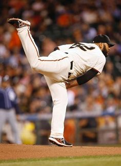 San Francisco Giants pitcher Yusmeiro Petit follows through on a delivery to the San Diego Padres during the first inning of a baseball game in San Francisco, Thursday, Sept. 25, 2014. (AP Photo/Tony Avelar)
