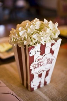 flowers in a popcorn box, great centerpiece idea