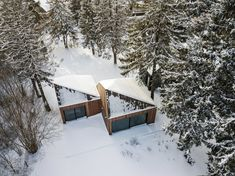 The pyramidal roofs of the cabins allow snow to slide down to the ground. Tagged: Exterior, House, Cabin Building Type, and Wood Siding Material.  Photo 2 of 13 in This Forest Retreat Is a Modern Take on the Traditional Estonian Hut