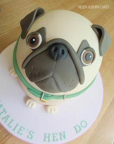 A Pug Dog cake I made for a Hen do. I'm not sure he wants to be eaten….look at his little face!