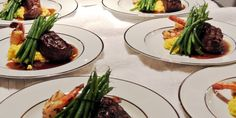 wedding reception food: Duo Entree with Succulent Shrimp  Petite Filet on creamy risotto finished with fresh asparagus