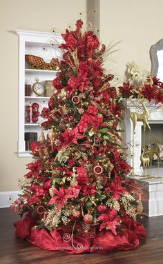 Superb Rich Christmas red and sparkling gold swirls combine for an elegant home decor stylized Christmas tree. www.seasonalconce…  The post  Rich Christmas red and sparkling gold swi ..