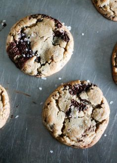Johnny Iuzzini's killer chocolate chip cookies with a few unique ingredients are truly one of the best! Crispy edges, puddles of chocolate and a little sea salt.