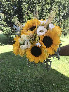 Bouquet di girasoli e spighe