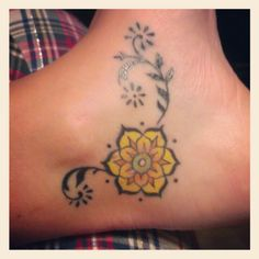 Ankle tattoo.  Open lotus.  Strength & perseverance.