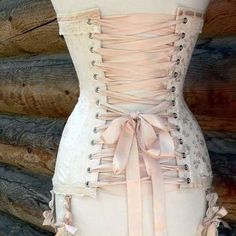 not such a big fan of Victorian corsets that go beyond the hips on myself, but on other people....*purr*