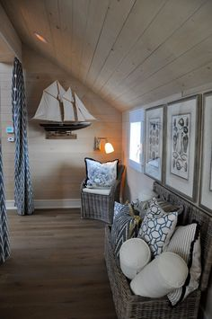 Love the driftwood colors of the floors, walls, and chest; the ship model, the seashell prints, and the blue