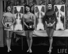 Finalists in the Miss Perfect Posture contest, 1956 OR they just went through the mako-nako machine at the airport.