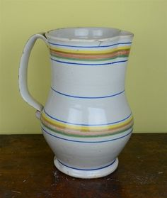 A large Spanish tin-glazed pottery jug