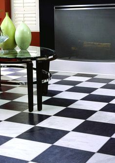 The Innovations Black and White Chess Slate laminate flooring has textures and a random pattern that capture the beauty of stone. The classic chessboard pattern looks great in a number of different decor styles.