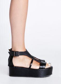 "Black platform sandal featuring reptile textured strap and buckle closure.  2"" platform"