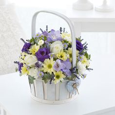 A charming basket arrangement of beauty for a baby boy.