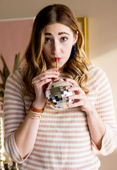 New year's eve outfit idea | what to wear for NYE | striped cropped sweater | disco ball tumbler