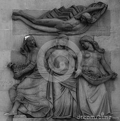 Shot in black and white, detail on an sculpture representing three  women placed at the facade of this historic building, set in Eixample, Barcelona, Catalunya, Catalonia, España, Spain, Europa, Europe