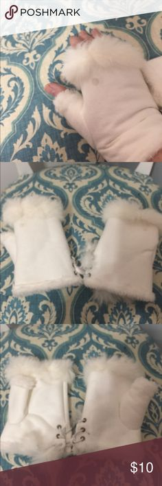 suede look and white faux fur Fingerless Gloves. Lined with white long . Has. Lace up on palm of Glove . Has the faux fur around there fingers and thumb . 6 inches in length Accessories Gloves & Mittens
