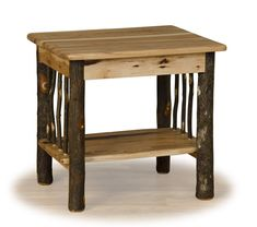 Natural hickory logs with bark are handcrafted into a sturdy rustic end tables or nightstands. The table top and shelf are both make with solid wood hickory boards. This rustic table will fit nicely into a log cabin, mountain retreat, or Adirondack camp.