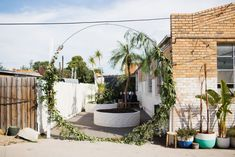 Forget a flower wall, how about a giant wreath (with the addition of flowers) for an amazing wedding or event entrance? / From Pop and Scott Studio Pop And Scott, Melbourne Wedding, Creative Workshop, Industrial Wedding, Light Photography, Flower Wall, Interior And Exterior, Greenery, Poppies