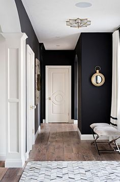 Black and white interiors. The black wall paint color is Benjamin Moore Onyx. Benjamin Moore Onyx The black wall paint color is Benjamin Moore Onyx. White trim paint color is Benjamin Moore Swiss Coffee Sarah St. Black Painted Walls, Dark Walls, White Walls, Black Bedroom Walls, Light Walls, Bedroom Neutral, Bedroom Doors, Trendy Bedroom, Style At Home