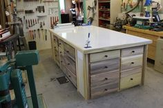 Assembly table  What I like: 1. Drawers for storage 2. Large worksurface 3. Ability to clamp