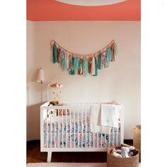Copper and teal in the garland is a beautiful mix in this cute nursery!Credit to DISC Interiors... - Home Decor For Kids And Interior Design Ideas for Children, Toddler Room Ideas For Boys And Girls