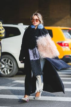 Lessons In Layering From The Streets Of New York City #refinery29  http://www.refinery29.com/2016/02/103173/ny-fashion-week-fall-winter-2016-street-style-pictures#slide-167  Fluffy coats, bags, shoes, and scarves — why not go all out and sport fluffy earrings, too?...