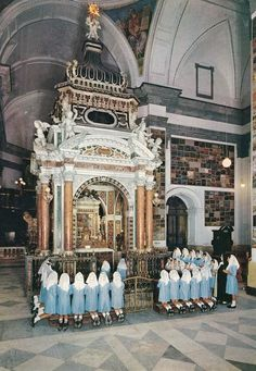 A group of orphans prayer before the shrine of the Madonna dell'Arco in Anastasia near Naples, Italy.