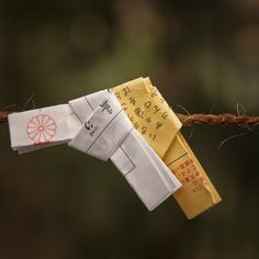 Omikuji - random fortunes written on strips of paper at Shinto shrines and Buddhist temples in Japan