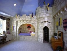 Castle bedroom and playroom in one, with two level turreted playhouse