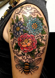 Colorful flowers been tattoo