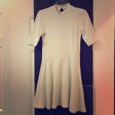 Reduced!!! TopShop off white textured skater dress Topshop off white textured skater dress, lightweight material, 3/4 sleeves, great condition, worn once Topshop Dresses