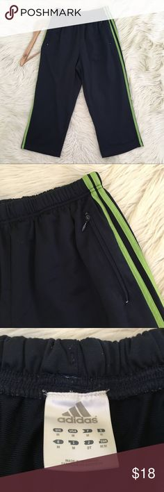 """Adidas Womens Medium Cropped Track Pants • Capri  • Blue with Green Stripes  • Excellent condition no flaws  Waist flat: 13.5"""" stretchy  Inseam: 21.5""""  Rise: 11.5""""  F16  📌NO lowball offers 📌NO modeling 📌NO trades  Come check out the rest of my closet! I have various brands and ALL different sizes! adidas Pants Track Pants & Joggers"""