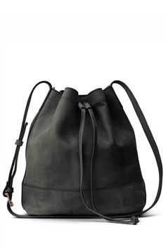 Handcrafted in Ethiopia, the Tadesse bucket bag by FashionAble. The adjustable strap allows you to wear it over your shoulder or across the body. 100% Ethiopian distressed leather.