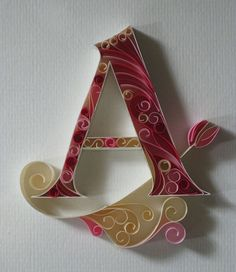 Beautifully ornate quilled letters