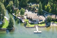 Imagine living on your very own private island. A lovely retreat surrounded on two sides by over 300 feet on the Spokane River and Hidden Island deep water canal! Unique granite in the kitchen reminds one of the flowing river.  Beautifully landscaped to waters edge. Private boat ramp for launching your toys. Plenty of dock space on both the River and Canal. 14-7758