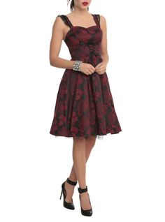 Red and black dress with an allover brocade design, ruffled shoulder straps, lace-up detailing and tulle lining.