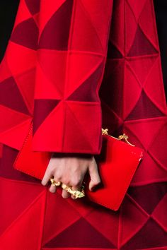 All in red, this is how to style  heavy textured checked red with red accessories and demure gold. NL x